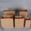 直销牛皮纸手提袋 牛皮纸打包袋 圆绳手提纸袋 现货可印刷LOGO